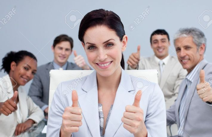 10095482-Businesswoman-and-her-team-with-thumbs-up-in-a-meeting-Stock-Photo