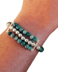 531 Turquoise and silver bracelet (one strand) on arm