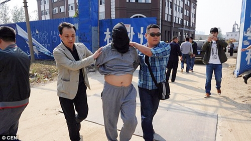 Chinese Billionaire Business Tycoon Arrested for Bank Robbery