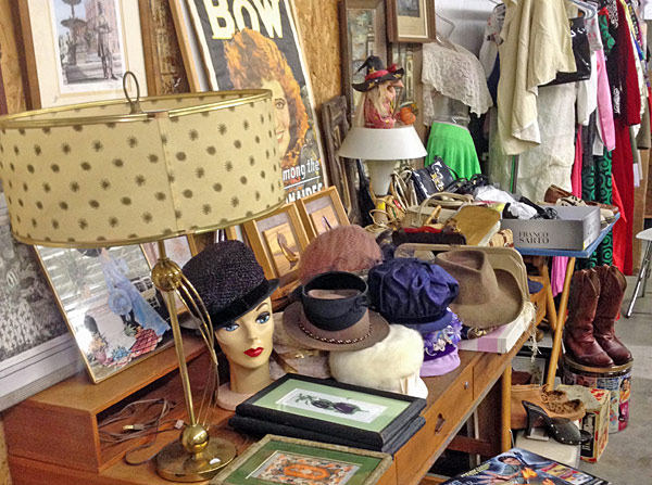 view of vendor table with vintage hats