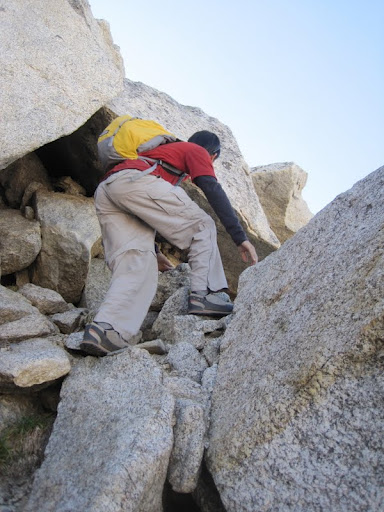 Me scrambling up the class 3 sections of the ridge
