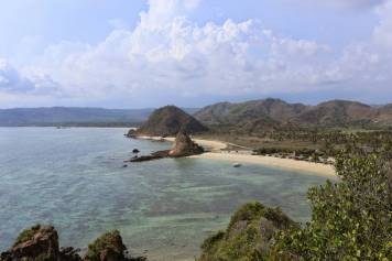 Under a scorching mid-afternoon sun, I took a wrong turn in the sand near the legendary surf beaches at Kuta. I took off my flip-flops and climbed up one of the promontories for a stunning view.