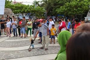 Cruel monkey show at Pantai Losari