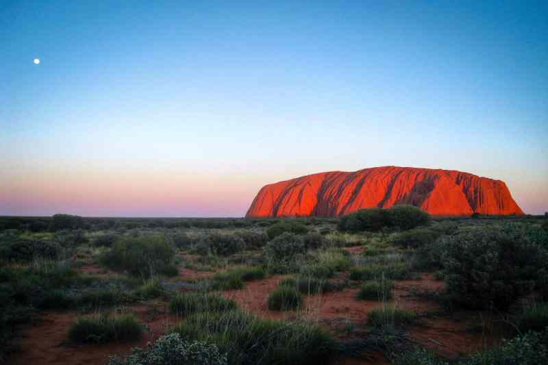 Traveling the world. Sunset over Uluru, Australia.