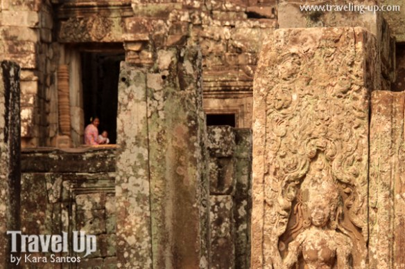 biking cambodia angkor archaeological park bayon carvings