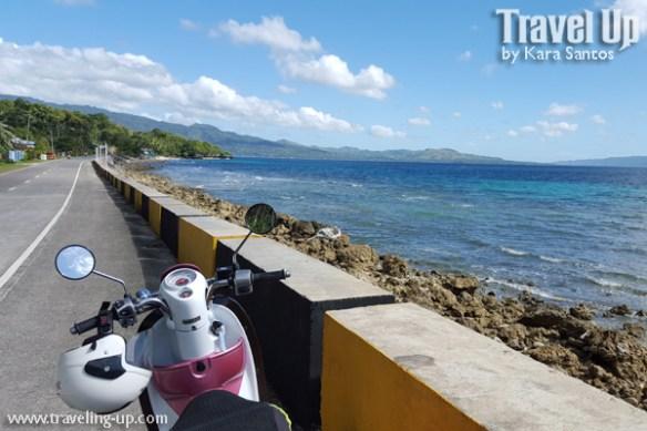 bohol by motorcycle coastal road scooter ocean