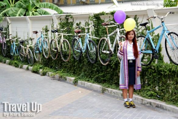bangkok thailand bicycle art installation girl balloons
