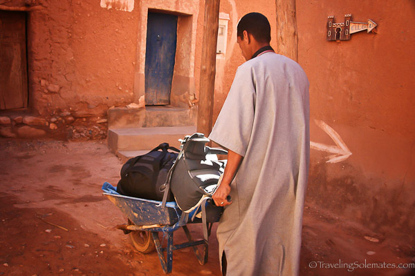 Tamdaght Kasbah Ellouze porter carrying luggage in wheel borrow
