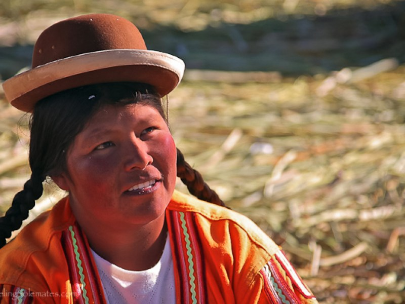 Uros woman wearing bowl hat n Floating Island of the Uros, Lake Titicaca, Peru