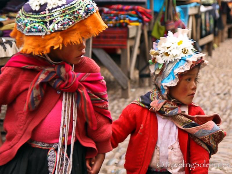 Little girls in Pisac market in Peru