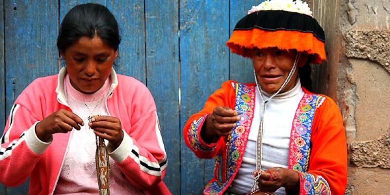 Women weaving in Pisac market Peru