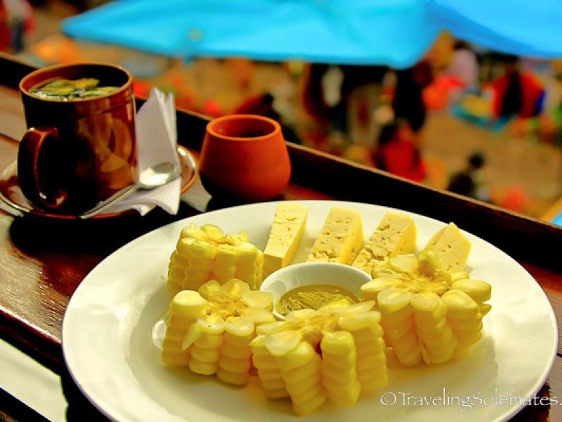 snack of corn and tea at Pisac Market Peru