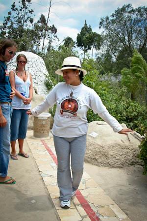 Balancing on equatorial line in Inti Nan Museum, Ecuador
