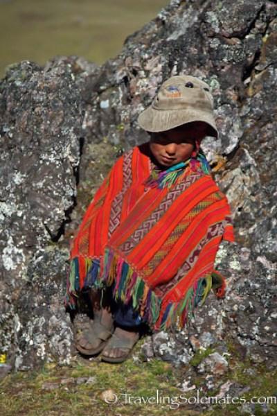 Little boy on the rock on Lares Valley Trek Peru