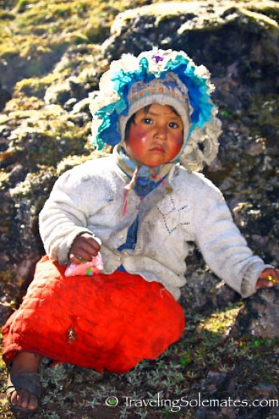 A little girl on trail of Lares Valley Trek Peru