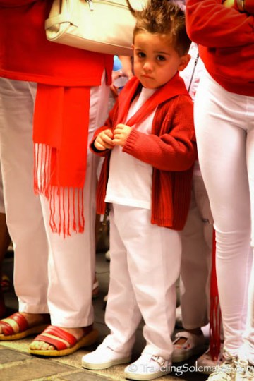 A boy for waiting for The Procession, Fiesta de San Fermin, Pamplona, Spain