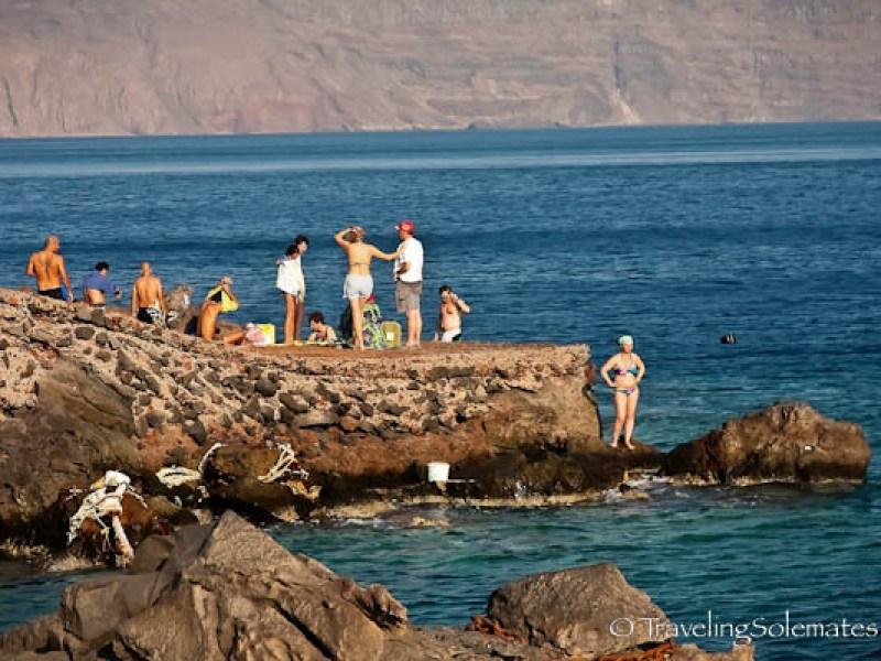 Bathers in Port of Ahmoudi, Santorini, Greece