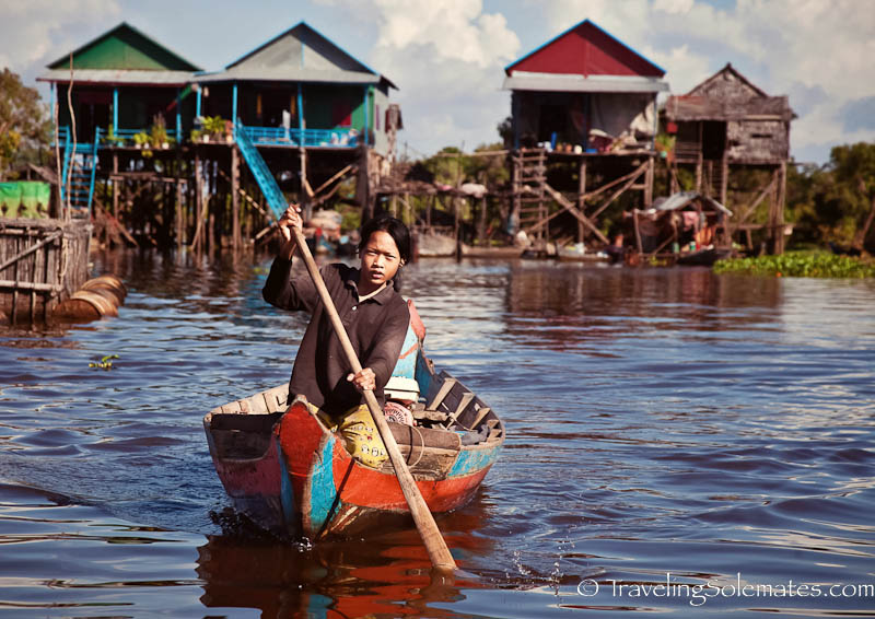 Girl rowing a boat, Kompong Phluk, Tonle Sap, Cambodia