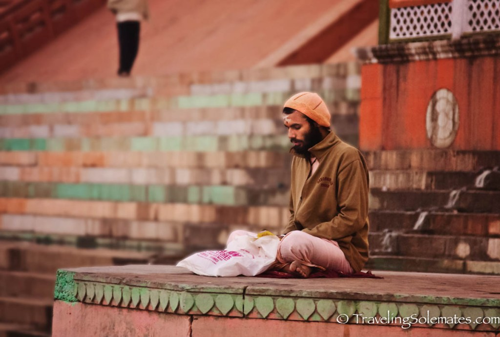 -A man meditating on a ghat along Ganges River, Varanasi India