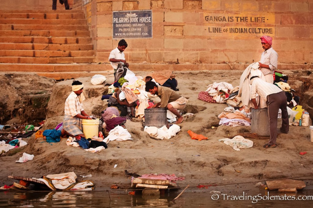 Men washing cloths in Ganges River, Varanasi, India