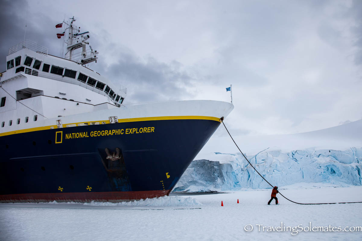 Man pulling ship, Nationnal Geographic Explorer in Port Lockroy, Antarctica