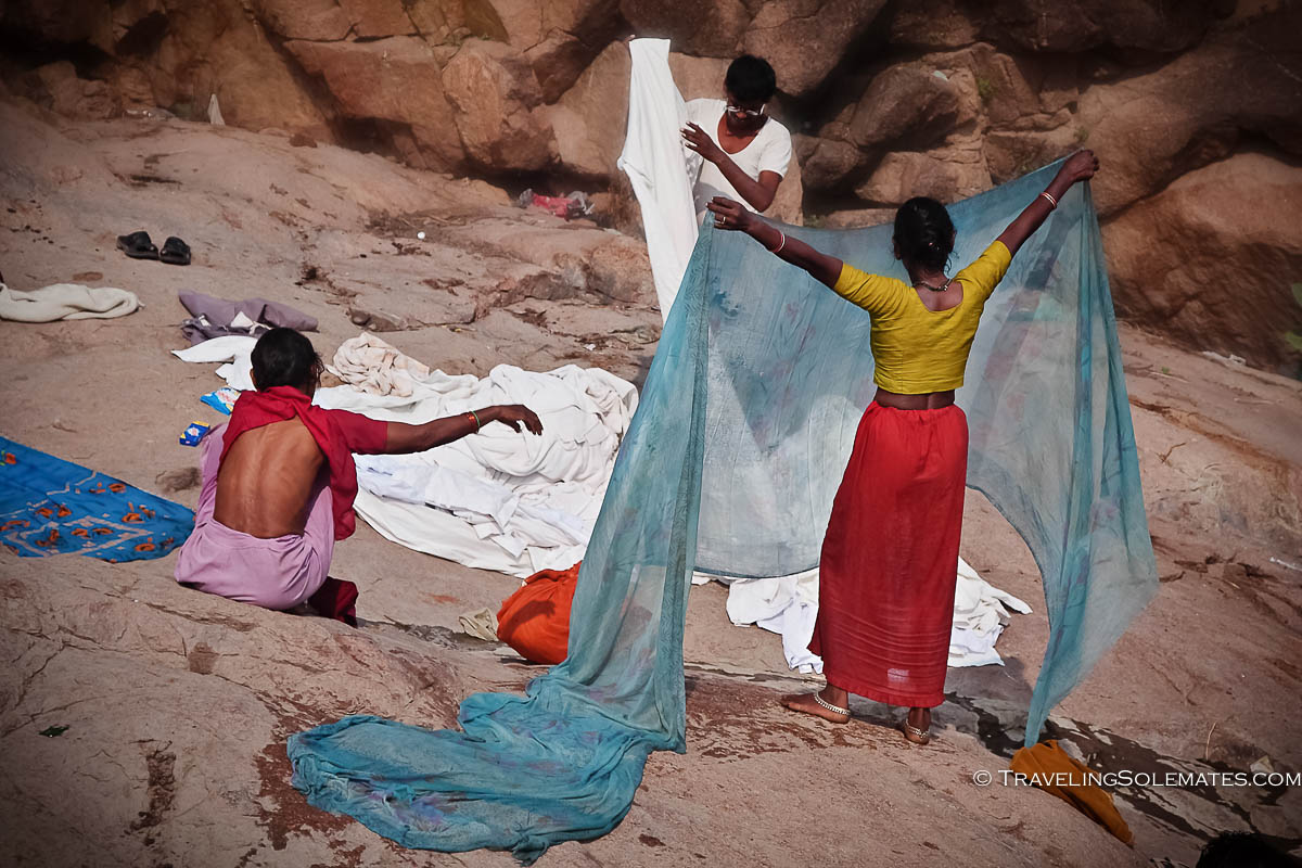Women washign clothes in Betwa River, Orchha, India