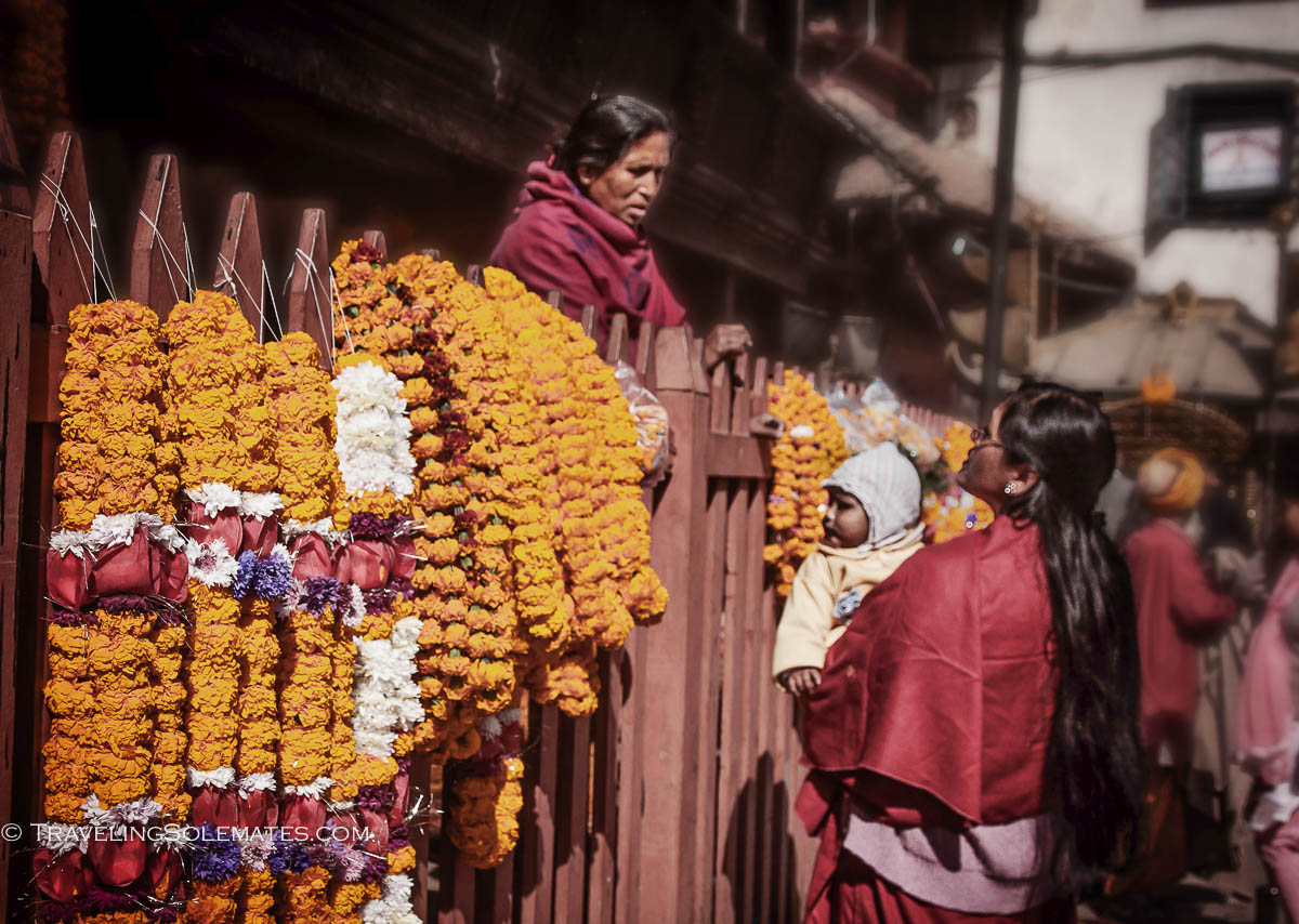 Woman outside a temple in Durbar Square in Kathmandu, Nepal