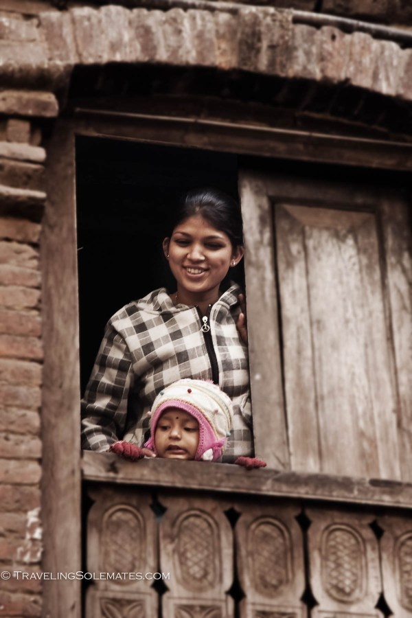 Woman and Child looking out of the window in Kathmandu, Nepal
