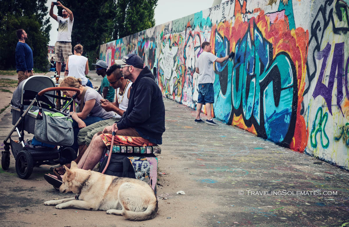 People relaxing by Berlin Wall in Mauerpark, Berlin, Germany