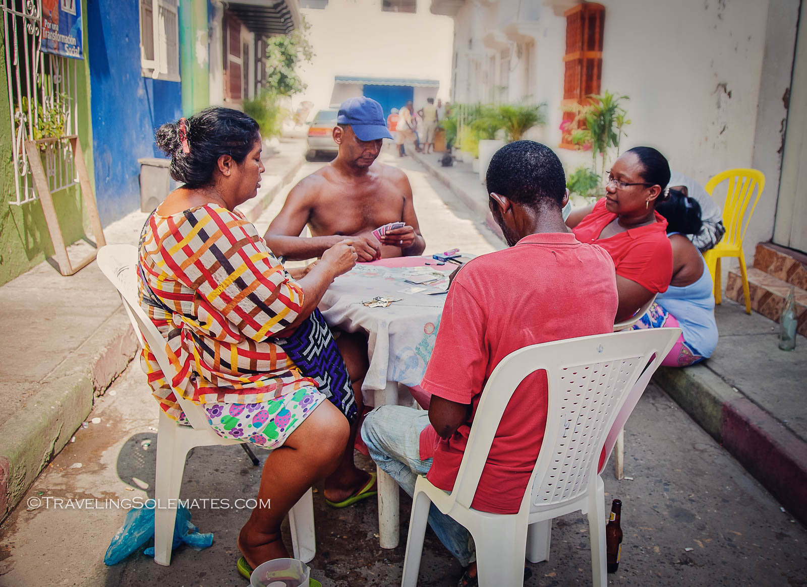 Locals playing cards on the street in Getsemani, Cartagena, Colombia