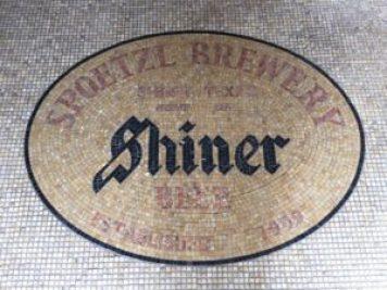 Mosaic tile greets visitors to K Spoetzl Brewery in Shiner, TX.
