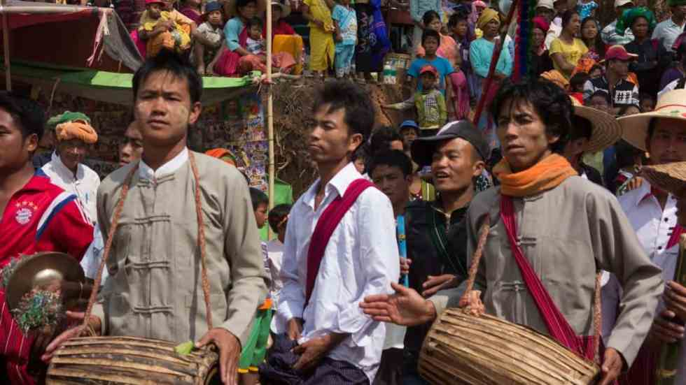Male family members performing instruments during procession ,Myanmar