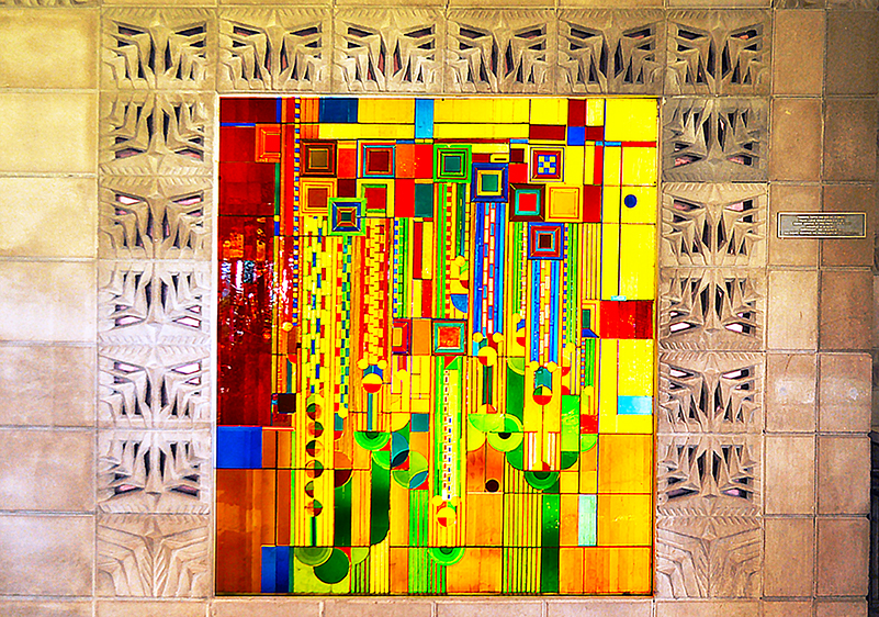 """Concrete blocks designed by Arthur Chase McArthur frame a stained glass window called """"Saguaro"""" designed by Frank Lloyd Wright in 1912 and fabricated in 1973 by a Mesa, Ariz. glass artist."""