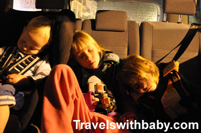 RideSafer travel vests help fit three across the back seat of a small rental car in Spain..