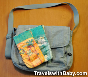 Simplify diaper changes on airplanes with a diaper purse.