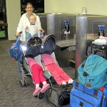 Kids sleeping in stroller at airport