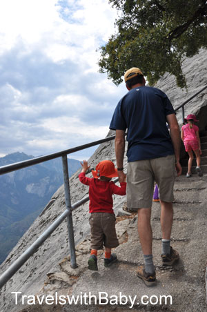 Little hiker holds Daddy's hand on Moro Rock trail