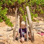 Toddler in pretend driftwood fort in Kauai
