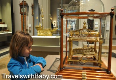 Child looks at clock in British Museum
