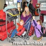 Family and suitcases at Paris CDG
