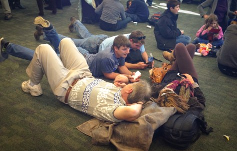Some people think it's okay to lay down on the floor near their departure gate.