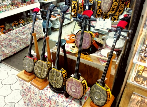 Shop sellinh musical instruments at a public market in Naha