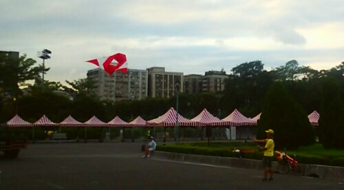 A man with a kite outside Dr. Sun Yat-sen Memorial Hall