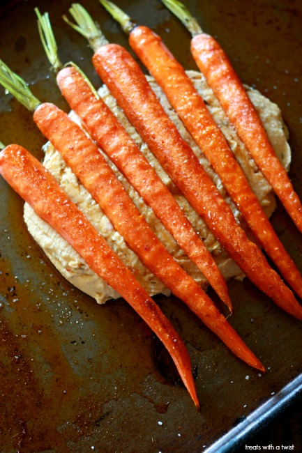 Honey Drizzled Roasted Carrots with Hummus // treatswithatwist.com