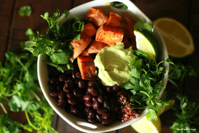 Roasted Sweet Potato and Black Bean Quinoa Bowls with Avocado Lime Crema // treatswithatwist.com