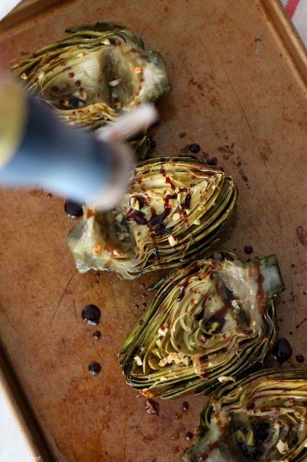 Roasted Garlic Artichokes with Balsamic Reduction // treatswithatwist.com