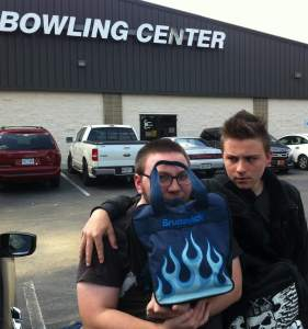 my boys standing in front of the bowling center