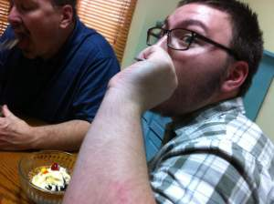Zachary eating a sundae