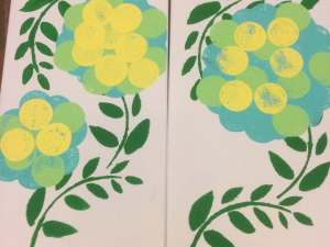 yellow is added to the blue and green flowers