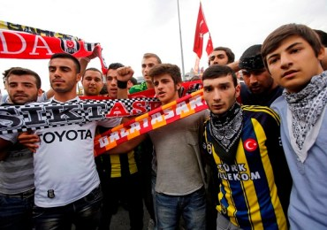 Fans of Besiktas, Galatasaray and Fenerbahce pose during an anti-government protest at Taksim Square in central Istanbul